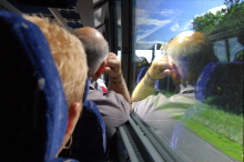 Passengers stare out of the window during a coach journey.