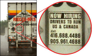 A large truck  with a sign on the rear door, 'Now hiring. Drivers to run US & Canada'