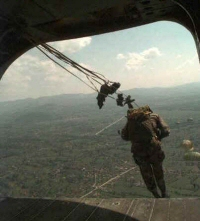 A paratrooper jumping from a plane.