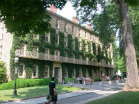 The frontage of west college at Princeton University, covered in ivy.